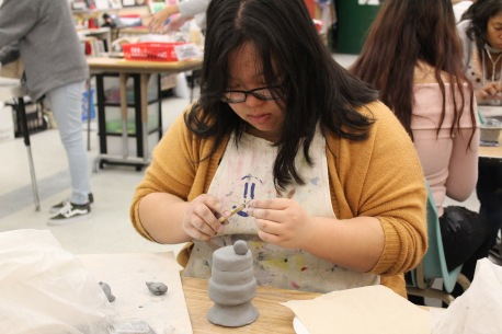 Kathy Moua (11) creates a dessert sculpture during Mrs. Graves 3D art class. (Clarion Photo by Makayla Smith)