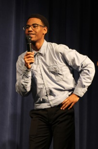 Allen Turner (11) performing standup comedy during 2nd Annual Youth Art Month Assembly (Photo by Nickee O'Bryant)