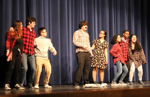 "Drama students (L to R) Kamryn Ebling (11), Parker Scarpa (11), Sidney Slesicki (11), Christopher Lee (11), Bernadette Tropel (11), Xochlit Guerrero (10), Allen Turner (11), and Cardid Cruz (11) performing Monty Python sketch ""The Lumberjack Song"" Photo by Izaack DeGuchy"