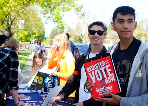 Branden Messick (12) and Daniel Fuentes (12) urge their fellow JFK students to register to vote.