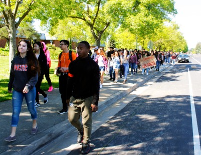 Kennedy students let their voices be heard as they march around the school campus.