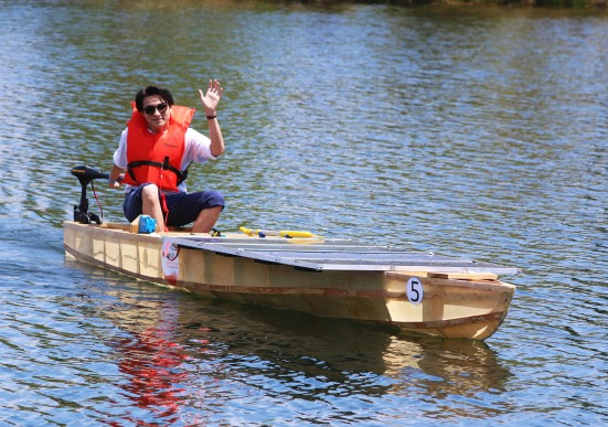 Theo Tran returns to shore after piloting the Kennedy watercraft during the slalom race.