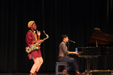 Ellis Penn (saxophone) and Harrison Arakawa (piano) entertained the audience with a mashup of various popular song parodies.