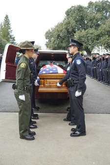 Corona casket with officers