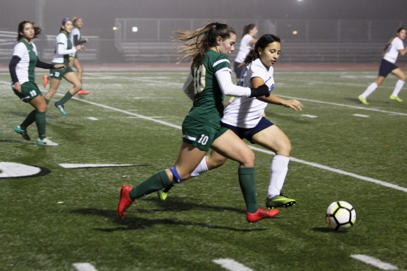 Kennedy varsity soccer player, Kyla Neely c/o 2022 races to control the ball against Burbank Photo by Zach Abay, Kennedy Yearbook.