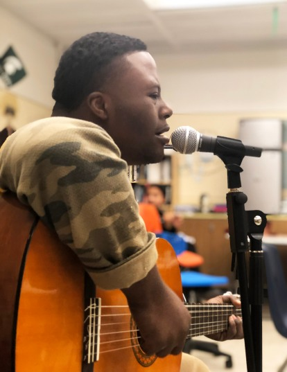Club Rock member Joshua Osinowo-Adeleye sits in with the band after school on April 2. Photo by B. Guildenstern