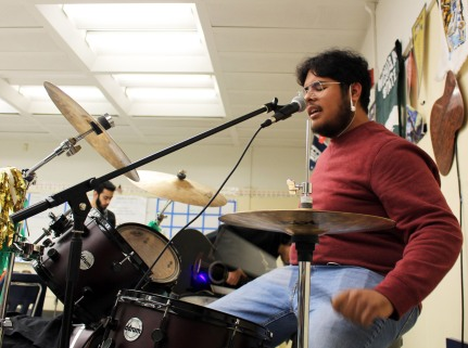 Club Rock president and drummer, Leo Batoon shown at work on his trap set after school on April 2. Photo by B. Guildenstern