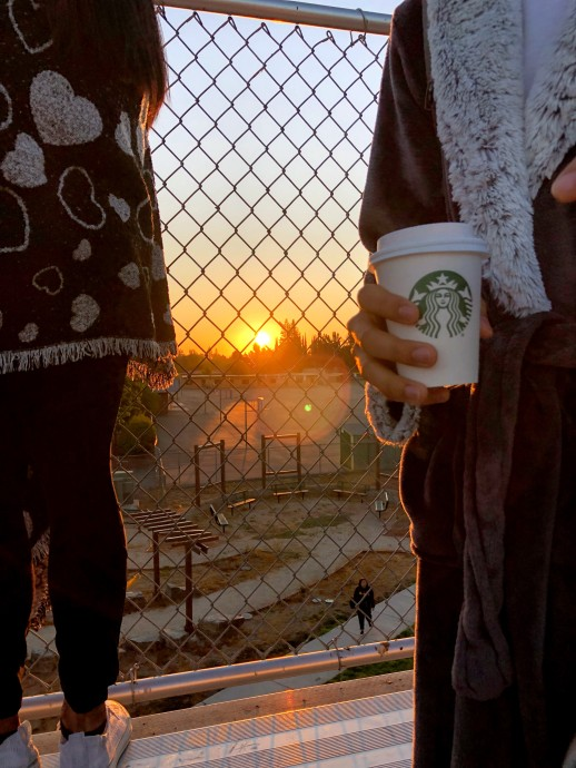 Watching the sunrise, students enjoy free drinks and doughnuts at Senior Sunrise on September 6, 2019. Photo by Amaya Searcy, Clarion Photo Editor