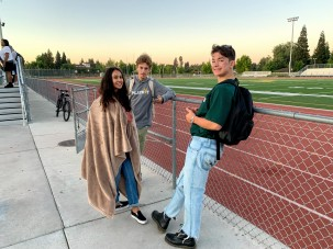 From left to right: Stephanie Aguire, Samuel Hewell, and Adam Montiel (Class of 2020), enjoying the beautiful sunrise and the wonderful view of Montiel's black Doc Martin boots at Senior Sunrise, September 6, 2019. Photo by Aleena Martinez, Clarion Photo Editor