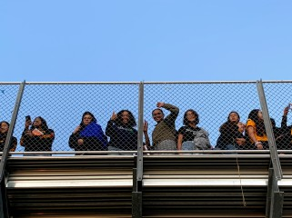 Cougars chillin' on the bleachers watch the sunrise at Senior Sunrise on September 6, 2019. Photo by Aleena Martinez, Clarion Photo Editor