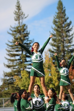 Krysty Yang (Class of 2021) and the Girls Cheerleaders Squad perform at the Homecoming rally at the Kennedy Stadium on Friday, October 18, 2019.