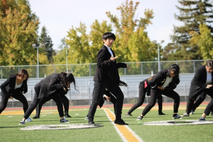 Victoria Duong (Class of 2021) and the Vibe in Promo (VIP) dancers perform at the Homecoming rally at the Kennedy Stadium on Friday, October 18, 2019.