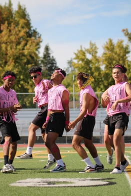 Boy cheerleaders from Powder Puff 2019 perform at the Homecoming rally at the Kennedy Stadium on Friday, October 18, 2019.