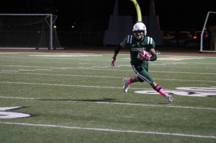 Varsity football player Xavier Calvin (Class of 2021) runs past the 20-yard line during the Homecoming Game against Laguna Creek High School at the Kennedy Stadium on Friday, October 18, 2019.