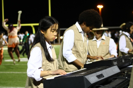 """The Kennedy High School Marching Band perform music from """"Jurassic Park"""" (composed by John Williams) at halftime during the Homecoming Game at the Kennedy Stadium on Friday, October 18, 2019."""