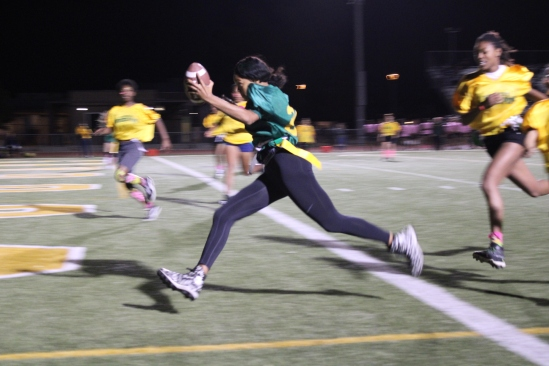 D'ausja Strain (Class of 2021) Powderpuff player runs and made a touchdown during the Powderpuff game at the Kennedy Stadium on Wednesday, October 16, 2019.