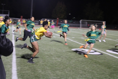 Billie Dee Scott (Class of 2020) Powderpuff player runs towards 20 yard-line during the Powderpuff game at the Kennedy Stadium on Wednesday, October 16, 2019.