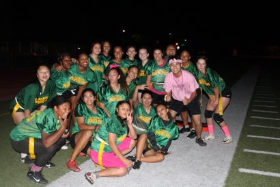 Junior (Class of 2021) Powderpuff team and a supported Powderpuff cheerleader pose after the field lights shut off unexpectedly during the powderpuff game at the Kennedy Stadium on Wednesday, October 16, 2019.